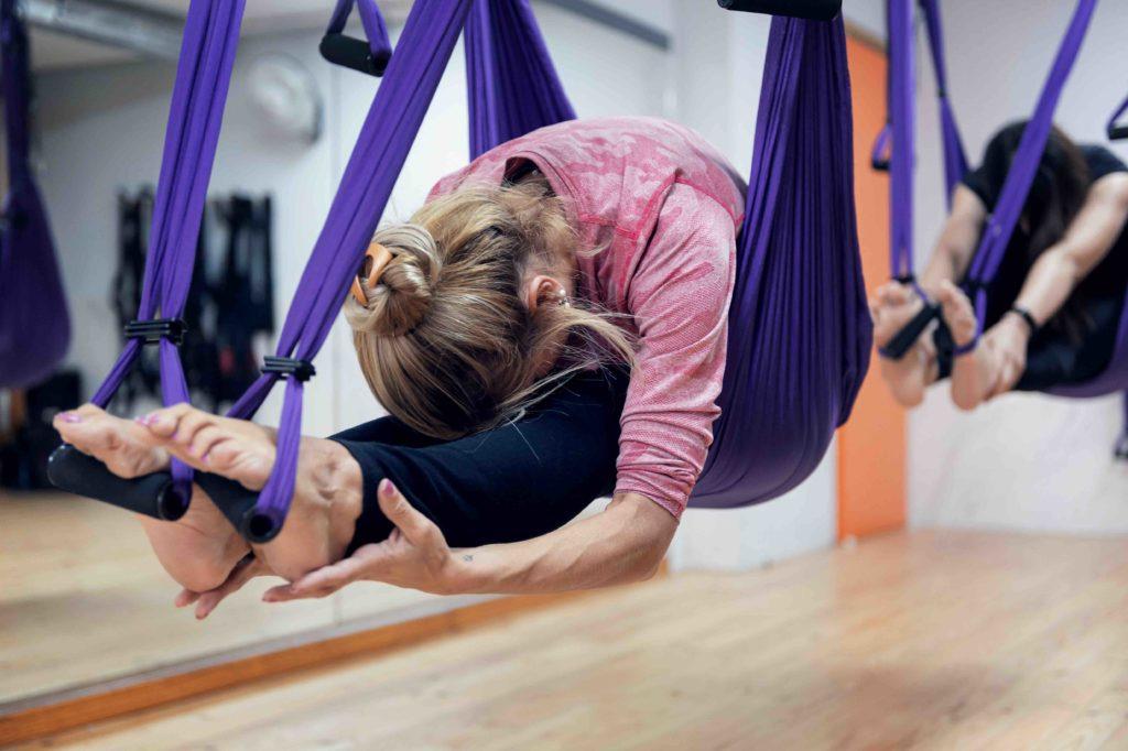 estirament corporal a una activitat dirigida